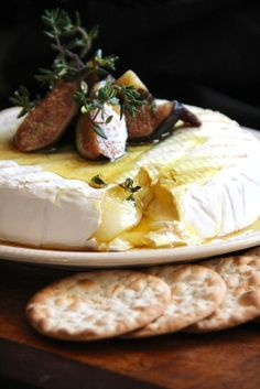 Grilled Brie with Figs & Thyme Honey. I could use Trader Joes Goat Milk Brie!