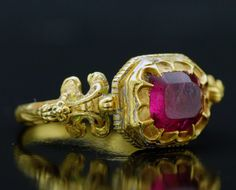 Enameled gold and red tourmaline ring. Renaissance period