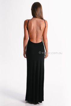 a simple clsasic black long dress with an open back