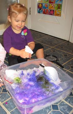 """Bring winter indoors!  Fill a bin with snow and let the children explore how it feels.  Give them water colors in spray bottles to let them """"color the snow"""""""