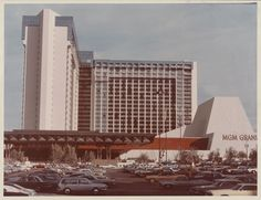 The old MGM Grand, c. 1973-79. The hotel is shown here in the years before the fire in 1980. The structure was remodeled, and reopened as Bally's in 1986. This front parking lot at the corner of the Strip and Flamingo Rd is now a garden covered by a mechanical people mover. Location. Photo: UNLV