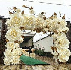 Stunning paper flowers!  This would be a great paper flower backdrop for a ceremony archway!