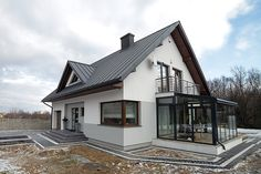 Polish architects Biuro Projektowe MTM STYL have taken a classic family home and turned it into the sweetest little space that you'll ever find. Future House, Double Storey House, Hotel Lounge, Attic Renovation, Facade House, Home Fashion, Modern House Design, Modern Farmhouse, Beautiful Homes