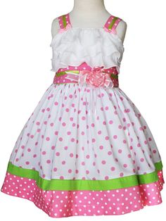 This girls minnie polka dot dress features green satin ribbons on the shoulder straps that end in little pink polka dot bows, the chest is accented with white ruffles, twirly polka dot skirt.