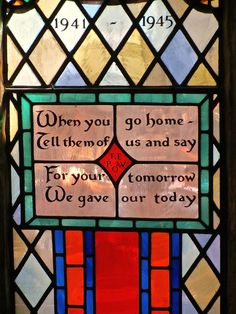 Very moving stained glass window in St Michael's Church. Oxford .England. Commemorating all those who died during  2WW