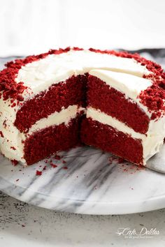 The most incredible Red Velvet Cake with Cream Cheese Frosting is fluffy, soft, buttery and moist with the most perfect velvet texture! Super easy to make with a few tips and tricks for the best results! You will go crazy for a second slice! | cafedelites.com