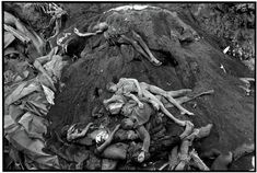 Magnum Photos Photographer Portfolio Gilles Peress ZAIRE. Goma. 1994. The victims of a severe cholera epidemic that spread throughout refugee camps in Goma, are buried. The dead were Rwandan refugees