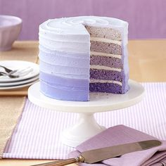 Five Shades of Violet Easy Layers! Cake. This attractive cake delivers a dose of purple passion. Use Wilton Easy Layers! Cake Pan Set to bake the layers easily. The simple violet purple ombre icing techniques allow you to decorate in a flash.