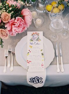 Wedding place setting with monogrammed napkin.