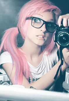 Pink hair and nerdy chic glasses.  The perfect combo
