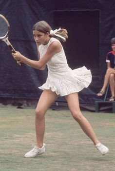 """ATHLETIC ACCOLADES: Won 157 singles titles and 32 doubles titles throughout her career. Competed in the 1988 Olympics. SARTORIAL SCORE: It's hard to believe Chris Evert could ever have merited the name """"Ice Maiden"""" in her flirty tennis ensemble and sweet hair ribbon."""