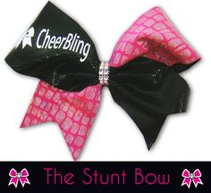 """This 3"""" wide bow is made with pink and black fabric. It is accented with a rhinestone center knot and secured on a black ponytail holder and features the CheerBling logo. Includes free USA shipping. Price $29.00"""
