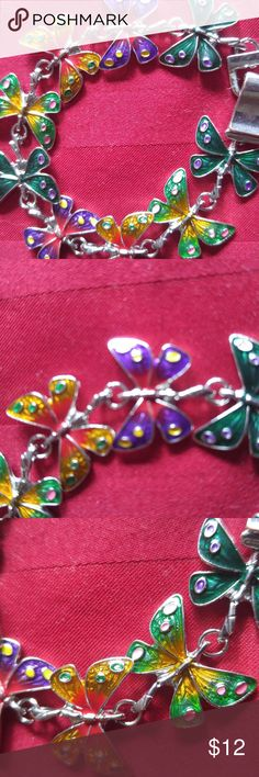 BEAUTIFUL BUTTERFLY BRACELET Handpainted butterfly bracelet set in silver. Wonderfully fun and a conversation piece. Accessories