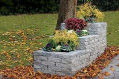 Gardening - Stack cast-concrete blocks in a tiered pattern to give your curb appeal a hefty boost. PICK THIS PROJECT! See the DIY tutorial. Stone Planters, Garden Planters, Brick Planter, Mailbox Landscaping, Garden Landscaping, Landscaping Ideas, Driveway Entrance Landscaping, Driveway Ideas, Landscaping Software