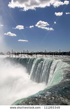 The view of the waterfall on the blue sky background. Niagara Falls, Ontario by Igor Sh, via ShutterStock