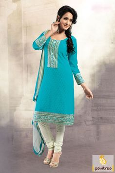The nice turquoise and white party wear embroidery salwar suit looks good with off white multi thread embroidery work on cotton material on front and back side.