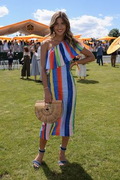 Rocky Barnes looked stunning at the Veuve Clicquot Polo Classic in this striped Mara Hoffman cold shoulder dress. We loved all of the  floral prints, straw bags, ruffles, lace and linen!