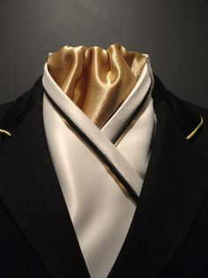 Cream, navy and gold stock tie by Equestrian Pzazz. Check out our page for more stunning designs www.facebook.com/eqpzazz #dressage #equestrianstyle #equestriancouture #horsetrials