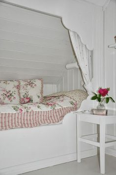 What little girls wouldn't adore sleeping tucked away in a bower of roses!? Lots of white draws more attention to the delicate colors in the fabrics.