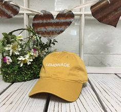 LEMONADE Baseball Hat Low Profile Embroidered BURNT YELLOW Baseball Caps Dad Hats White Thread by TheHatConnection on Etsy https://www.etsy.com/listing/278288550/lemonade-baseball-hat-low-profile