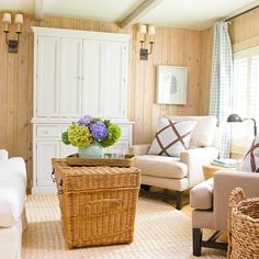 Cottage Cozy...love the wicker trunk, the touches of aqua, buffalo check curtains, sisal rug