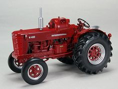 International W400 LP Gas Diecast Model Tractor by SpecCast ZJD1726 This International W400 LP Gas Diecast Model Tractor is Red and features working steering, wheels. It is made by SpecCast and is 1:16 scale (approx. 20cm / 7.9in long).    #SpecCast #ModelTractor #International