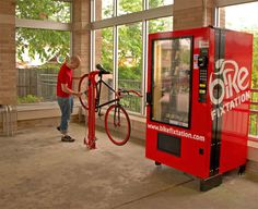 Bike repair vending tools hang from red post and you may buy parts from machine