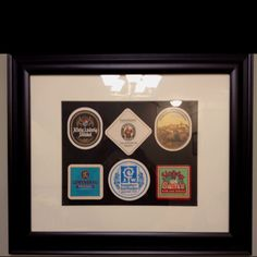 Not a very good picture but great idea! Various pub coasters from all over in picture frame-great bar accessory!!