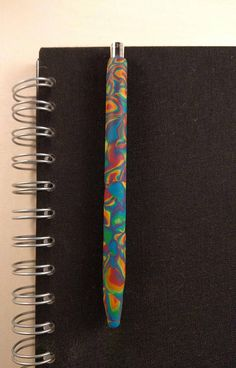 Ballpoint pen - Fimo (polymer clay) covered refillable retractable Caran d'Ache ballpoint pen in psychedelic rainbow colours Polymer Clay Pens, Polymer Beads, Psychedelic Colors, Caran D'ache, Stationery Pens, Beautiful Handmade Cards, Black Felt, Ballpoint Pen, Rainbow Colors