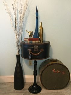 Vintage black hat box luggage entry table. by ParkersMantiques on Etsy https://www.etsy.com/listing/246581723/vintage-black-hat-box-luggage-entry