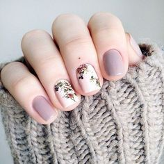 This #nail design is so cute. I love the #purple nail polish and the #floral design. | @andwhatelse