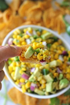 Avocado Corn Salsa 2 cups corn kernels 1 jalapeño, seeded and diced 1/4 cup diced red onion 2 tablespoons chopped fresh cilantro leaves 2 tablespoons freshly squeezed lime juice 1 teaspoon sugar 1/4 teaspoon salt 1 California avocado, halved, seeded, peeled and diced Green Giant Veggie Snack Chips, for serving (I'd make this without the sugar of course)