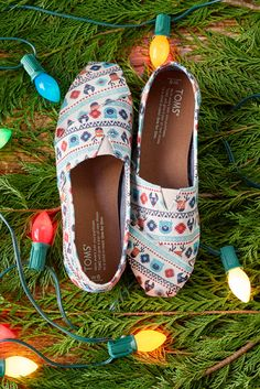 It's beginning to feel a lot like the Christmas with TOMS slip-on shoes in festive prints and patterns.