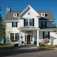 A traditional lake house designed by Edward Postiff Interiors in Michigan-Go jump in the lake! A beautifully classic white house with black shutters built on Lake Michigan with gorgeous water views. Best White Paint, White Paint Colors, White Paints, Traditional Exterior, Traditional House, House 2, Exterior Tradicional, White Exterior Paint, Design Exterior