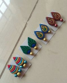Trendy ear studs colorful for matching your daily outfit 4 Terracotta Jewellery Making, Terracotta Jewellery Designs, Terracotta Earrings, Antique Jewellery Designs, Handmade Jewelry Designs, Polymer Clay Embroidery, Polymer Clay Crafts, Polymer Clay Earrings, Teracotta Jewellery