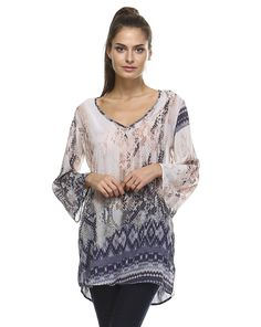 Summer tunic… Exclusive Italian Print; In a fresh silky soft fabric. Taj features deep V-neck line and long sleeves. Composition : - Viscose And Silk Chiffon - Approximate Length From Shoulder to Seam