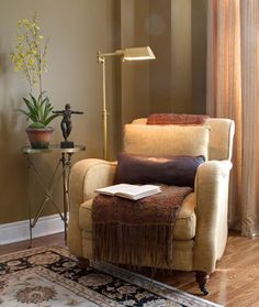 Small Space Decorating: If you are placing a chair in a tight corner, use one with rounded arms so it's easier to get around and softens the sharpness of the corner.