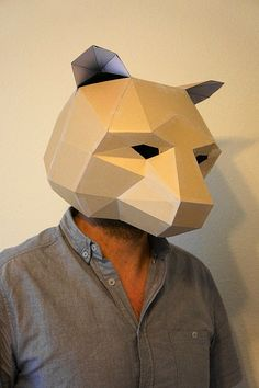 These plans and instructions enable you to make your own 3D bear mask from waste card.  This mask is really simple to make and the construction