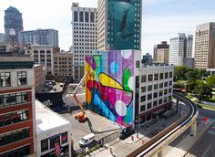 HENSE's mural on the madison theater building in downtown detroit took three weeks and over 100 gallons of paint to complete.