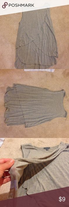 Gray flowy shirt This is sort of like a T-shirt but more flattering. It has a double layer that criss crosses the front. Very lightweigt. Lilla p Tops Tank Tops