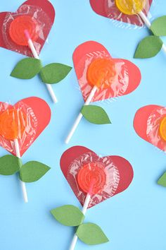 These heart-shaped flowers are a perfect way to display sweet treats like a lollipop.