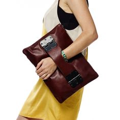 Interesting way to hold bag. Bowdoin Clutch Ox Blood by Hayden-Harnett