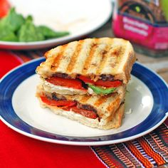 YUM Panini with roasted red pepper, spinach, goat cheese, and olive tapenade.