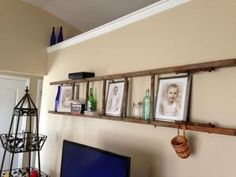 """Repurposed old wooden ladder. Used """"L"""" brackets to hang away from wall. Vintage ladder reuse, wall, shelf. by latasha"""