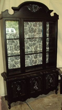 Old china cabinet painted black and lined w/toile. Great new look.