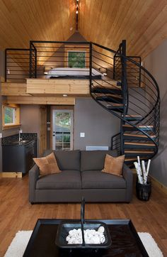 Olympia Eld Inlet Cabin Remodel and Studio Addition. A lovely loft with that beautiful ironwork and curved stairs. | Tiny Homes