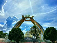 Guarding the entrance to Brunei's Jerudong Park, the Crystal Arch is the world's largest diamond replica. This soaring monument is the length of a city block and weighs an estimated seven tons, its columns decorated with millions of tiny gold mosaic tiles.    Photo credited to geekinwhite.com