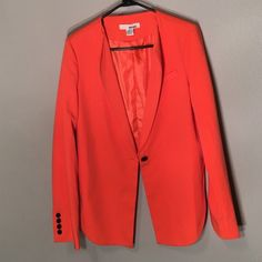 Sans Souci Orange Hi Lo Blazer Work once. Orange blazer with black buttons on wrists and one black button at waist! Would probably fit 6-10/12 best! Sans Souci Jackets & Coats Blazers