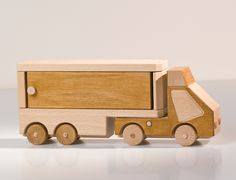 Toy car with open cargo space. Made from select beech wood. Finishing dual tone soft wax finish.