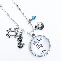 """• Under the Sea Necklace • Please DO NOT buy this listing as I have more than one available. Comment below and I'll make a separate listing for you. Handmade Zinc alloy silver material. Lead and nickel free. 18"""" length chain.   •price firm unless bundled •no trades •10% off all bundles Jennifer's Chic Boutique  Jewelry Necklaces"""